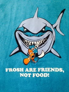 "Link Crew leaders are recognizable by their ubiquitous class shirts. The shirts feature a pun on a famous line from the movie Finding Nemo: ""Frosh are friends, not food!"""